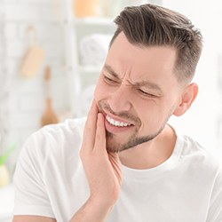 Man with toothache before tooth extraction